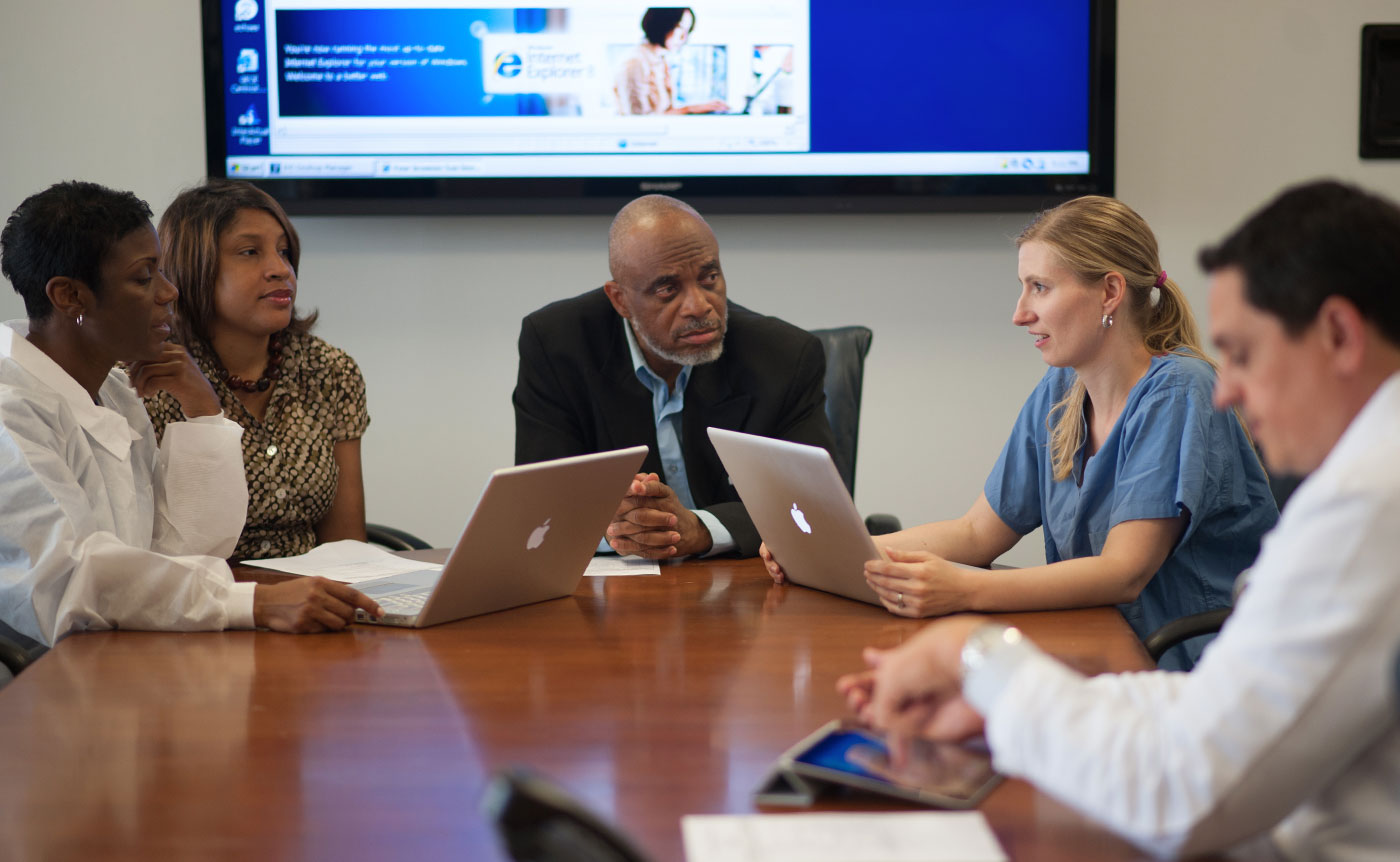 A group listens to a webinar.