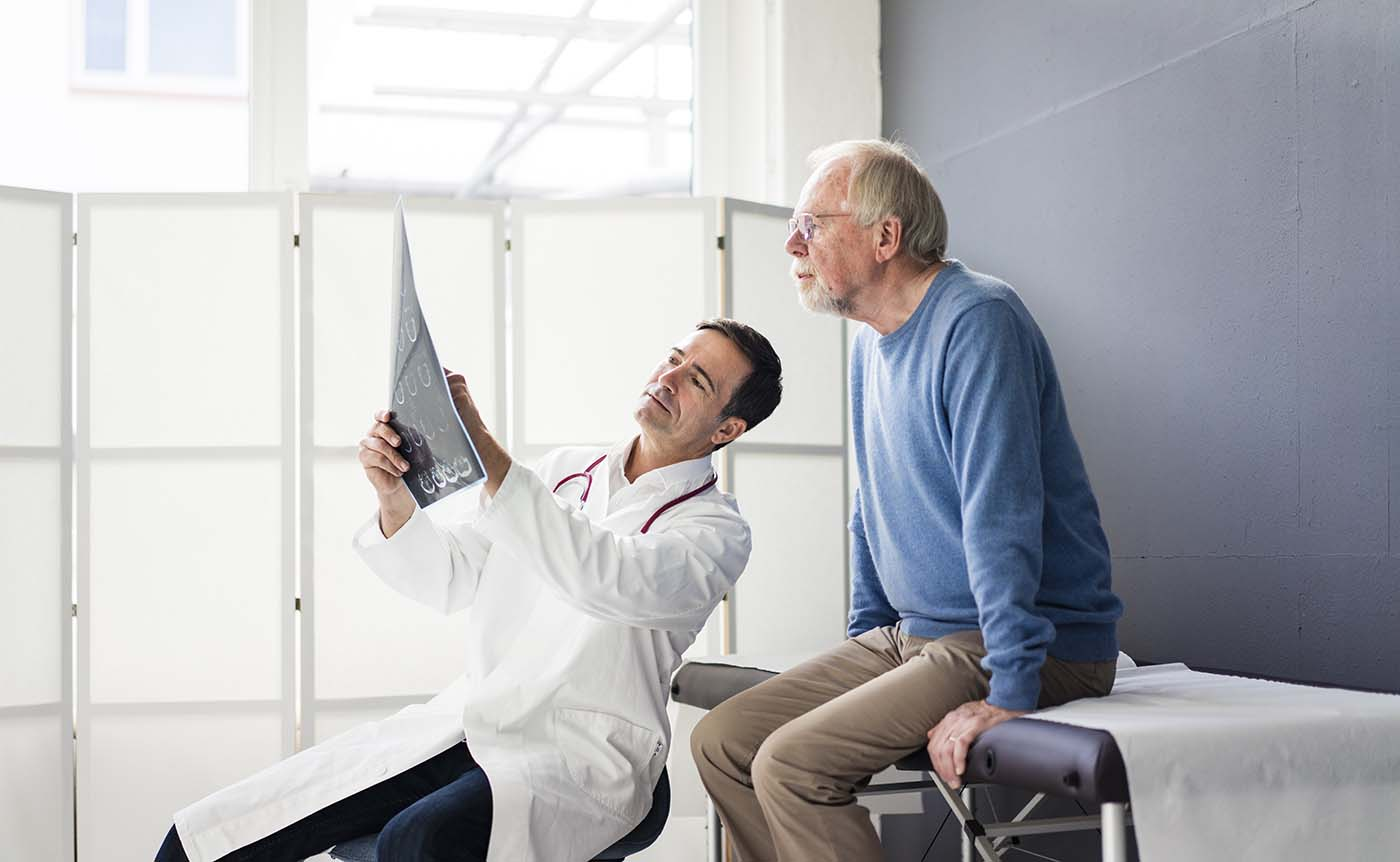 Physician is showing x-ray to the patient