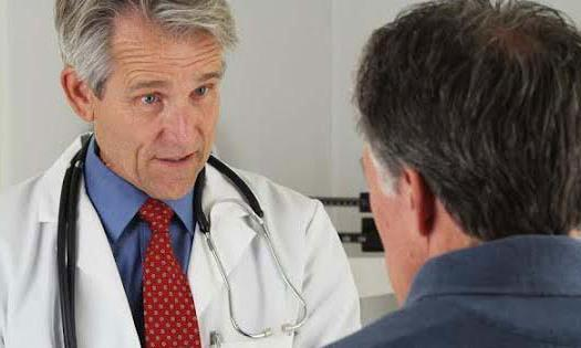 A patient in consultation with his doctor