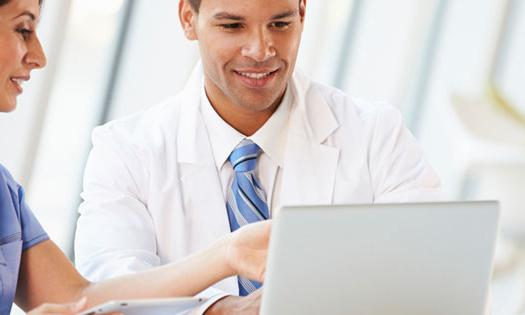 Two doctors looking at a laptop