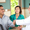 health care professionals greet a patient