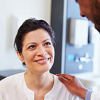 health care professional consults with a patient