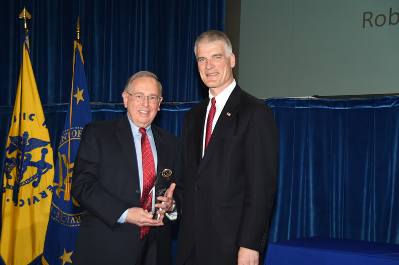 HHS Chief of Staff Peter Urbanowicz recognizes James Cleeman, M.D., AHRQ's Director of the Division of Healthcare-Associated Infections in the Center for Quality Improvement and Patient Safety, with the HHS Secretary's Award for Distinguished Service during the 2016-2017 Departmental Awards Ceremony in Washington, DC. Dr. Cleeman received the award in recognition of his achievements in improving the health of Americans over the course of his more than 40-year career in HHS.