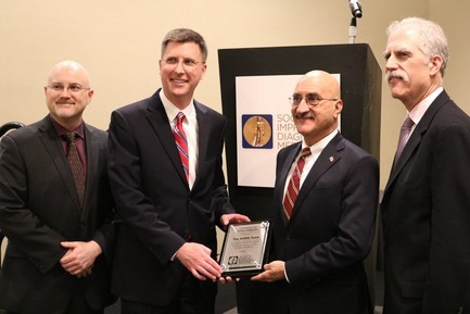 Attending SIDM's annual conference are, left to right, David Newman-Toker, M.D., Ph.D., SIDM president; Jeffrey Brady, M.D., director of AHRQ's Center for Quality Improvement and Patient Safety; Gopal Khanna, M.B.A., director of AHRQ; and Paul Epner, M.B.A, SIDM chief executive officer.