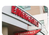 Photograph shows the entrance to a hospital emergency department.