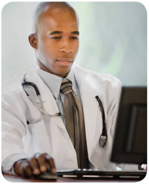 Image: A physician is shown using a computer.
