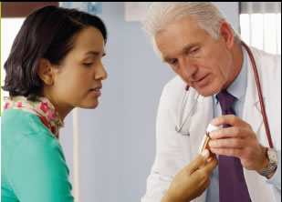 A woman consults a physician about her medication.