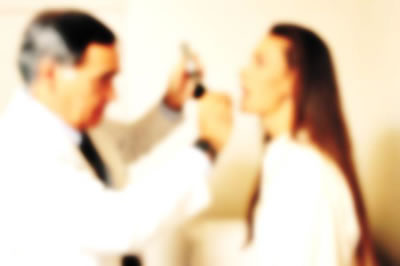 Blurry photo of doctor and patient.