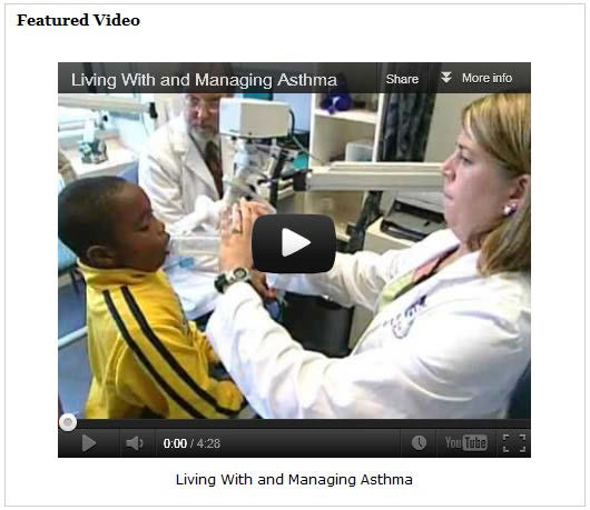 Screenshot of a video about asthma, showing a doctor checking a little boy's breathing.