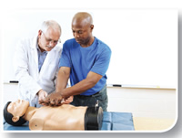 Image of student practicing chest compressions on a mannequin.